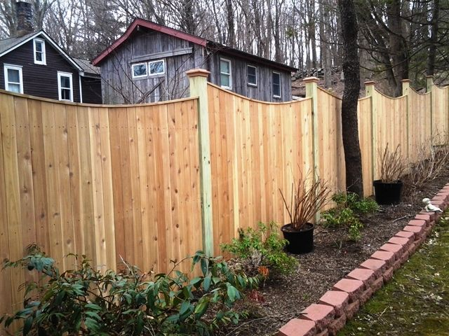 Capped Scalloped Stockade Privacy Fence