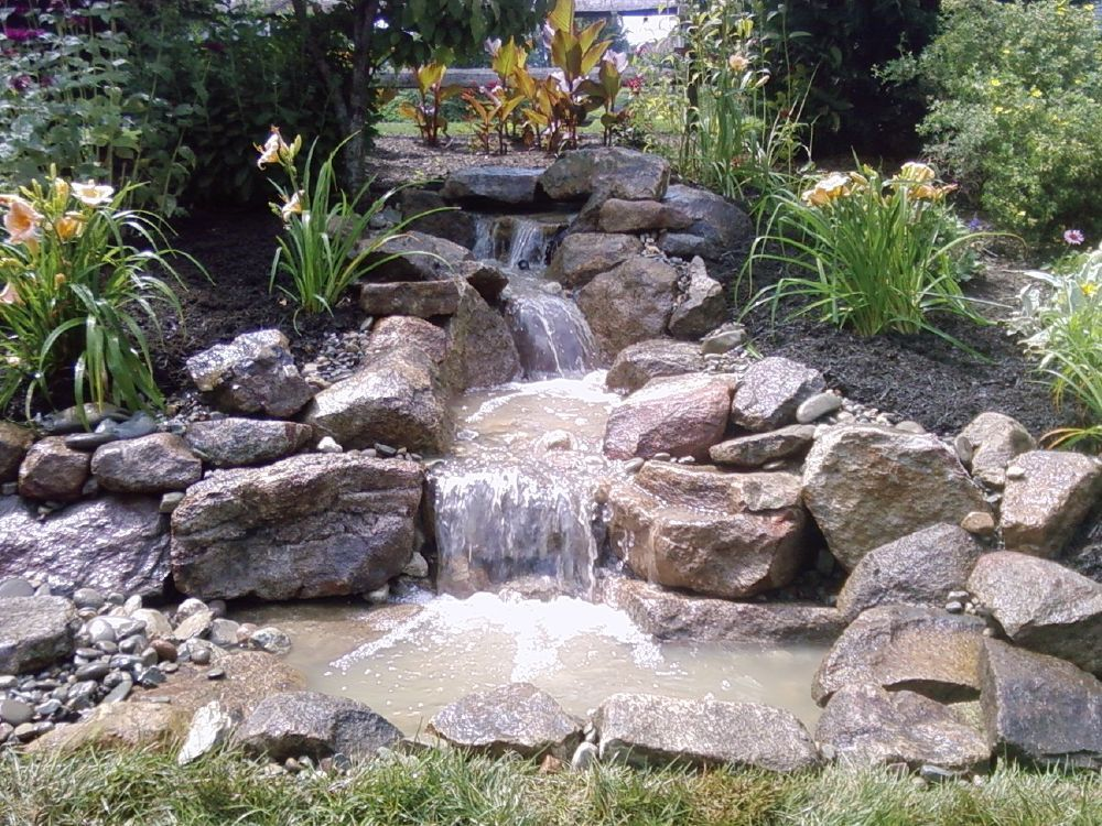 Pondless waterfall build pond water features water for Stone garden waterfall