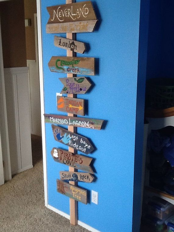 Heading to Neverland direction sign with crocodile creek, mermaid lagoon, pirate's cove, London, lost boys hideout.