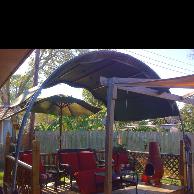 Deck Cover Made Out Of A Trampoline Tarp And Bungee Cords Using Half Of An Old Trampoline Frame A Tarp And Some Backyard Trampoline Old Trampoline Backyard