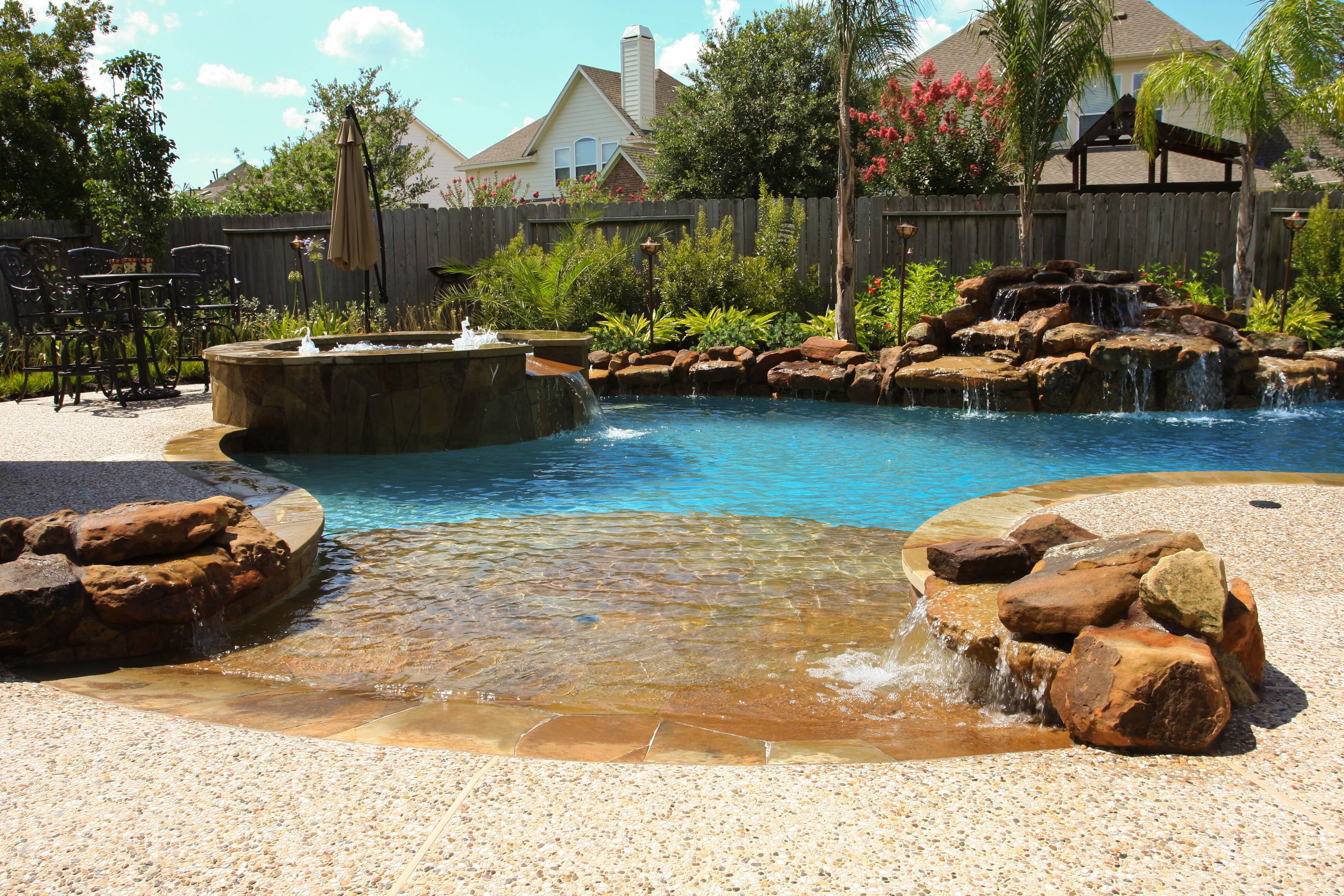 Flagstone Beach Entry Moss Rock Accents And Waterfall With Spa Pool Waterfall Backyard Pool Pool Patio