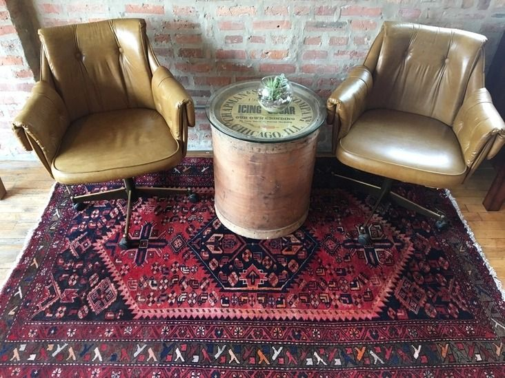 Pair of vintage Douglas chairs with brass-colored accents on the bottom. A perfect contrast to a colorful rug.