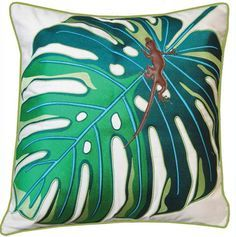 A beautifully-embroidered palm leaf, and a funky, lizard applique make up BOXHILL's Palm + Lizard Outdoor Pillow. This pillow's solution-dyed acrylic will hold its bright colors for years to come. Rear solid kiwi panel, with kiwi piping, and a hidden zipper.