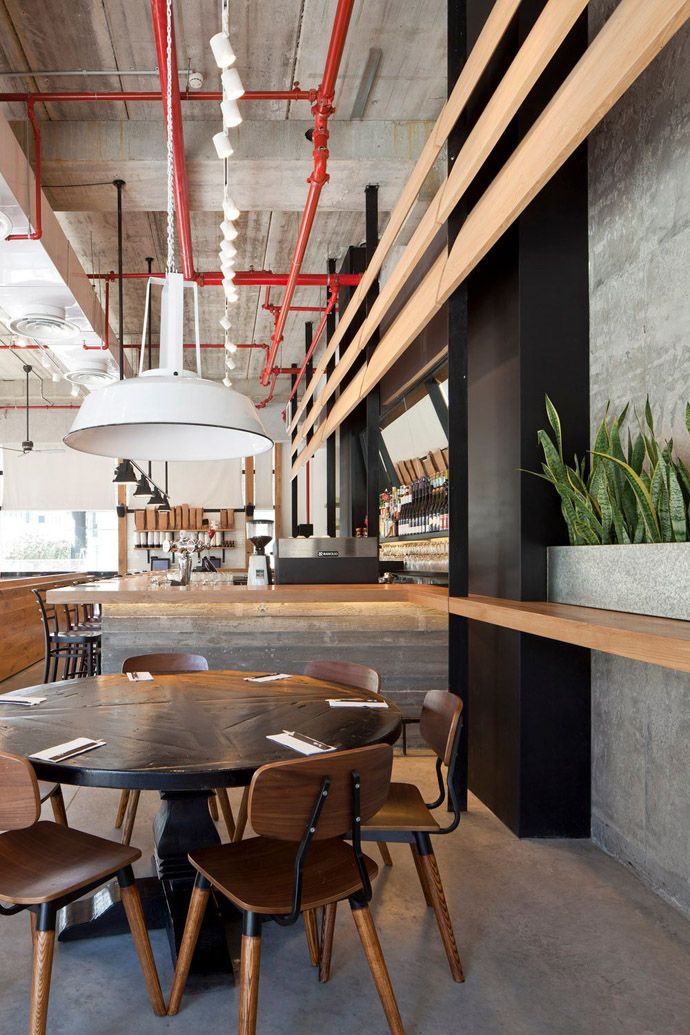 industrial look wood and concrete for giraffe restaurant tel aviv