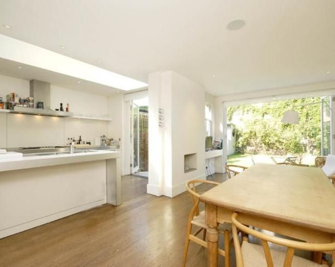 Photo Of Luxury Open Plan Kitchen Dining Room Garden Living With Fireplace Oak Flooring And Table