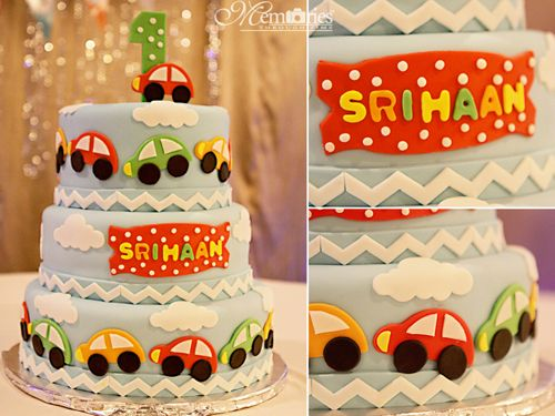 first birthday red yellow green car themed party tiered cake cars
