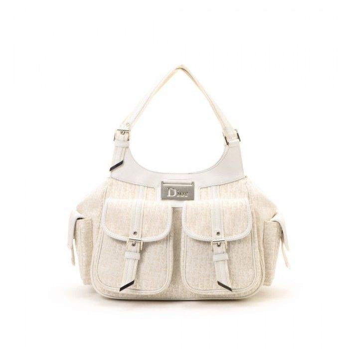 LXRandCo guarantees the authenticity of this vintage Dior Street Chic  shoulder bag. This luxurious purse was crafted in trotter canvas in ivory. 481c160808