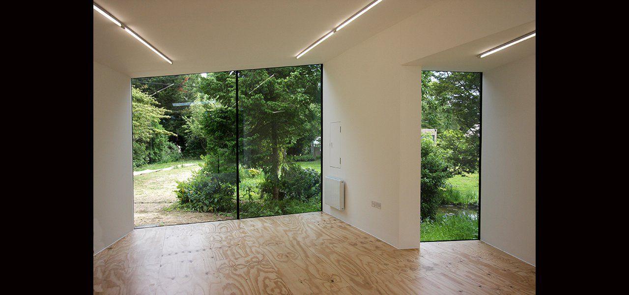 Frameless structural glass windows to garden studios by IQ Glass