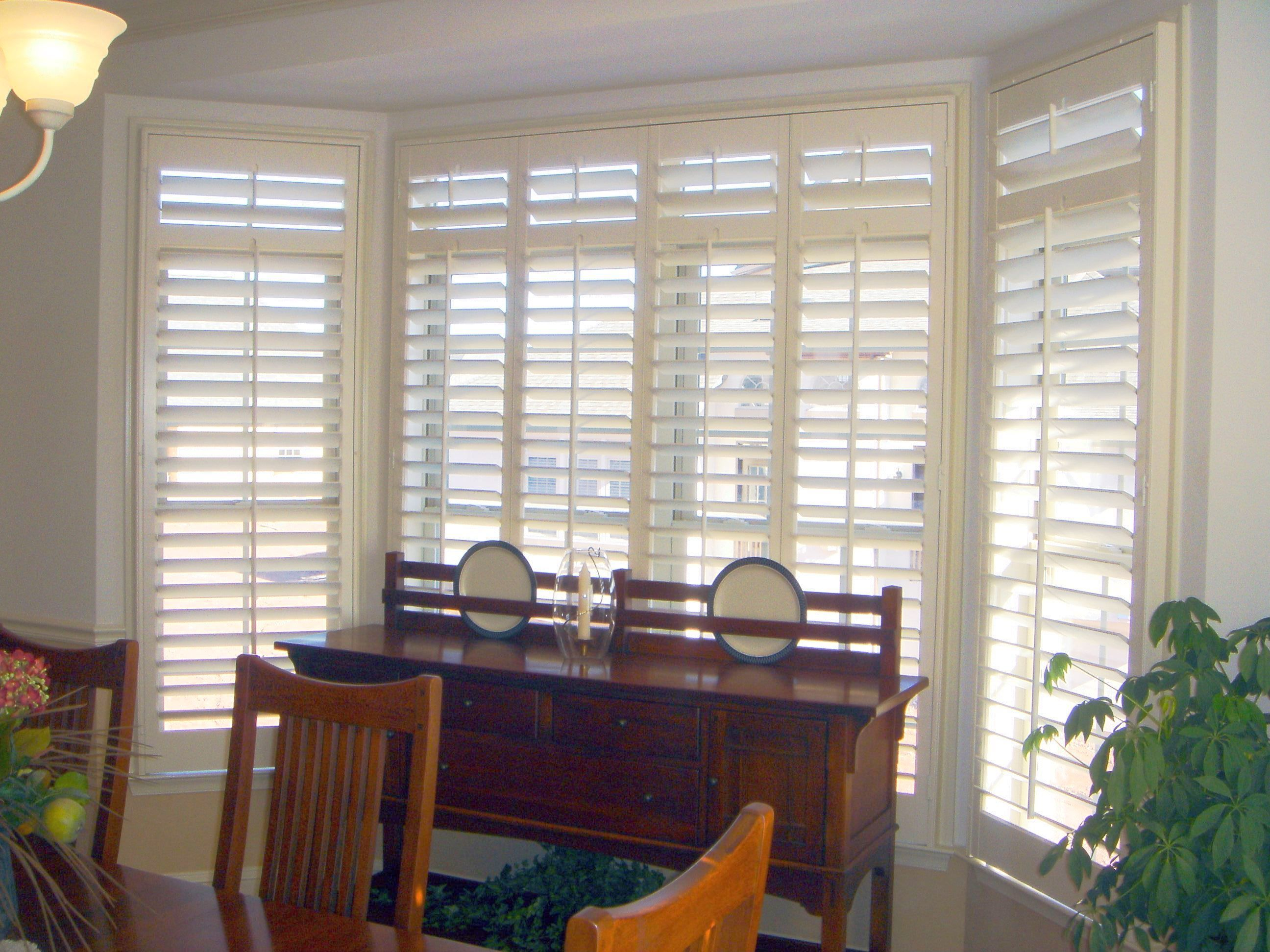 Shutters on a bay window. Custom shutters, Wood shutters