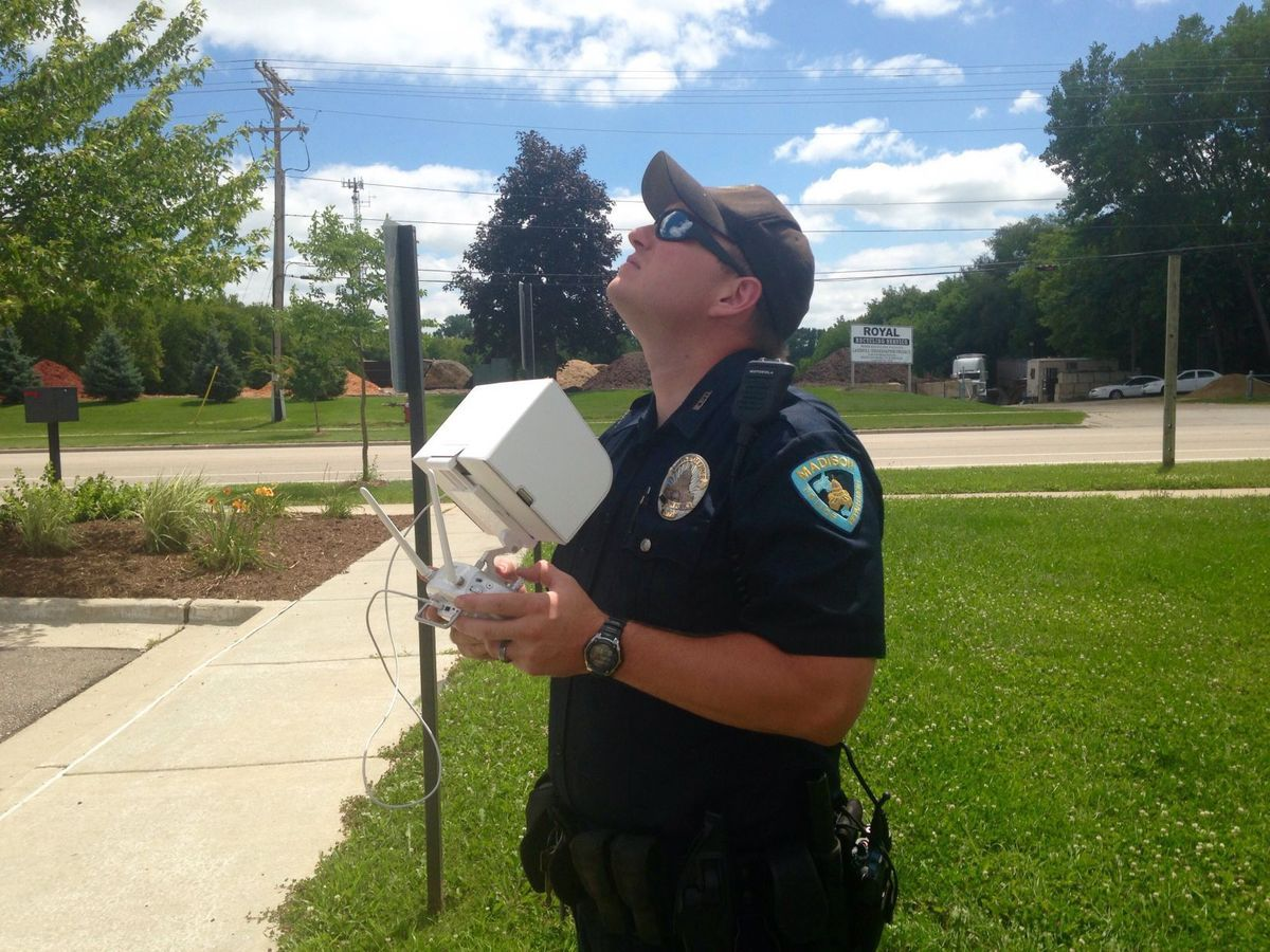 A Madison Police Department Officer Operates One Of The Department S Two New Drones The Mpd Officially Launched Its New Dr New Drone Police Department People
