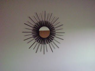 Sunburst mirror tutorial.  I like the weightier feel of the center area in this version, but perhaps would use a squared off end of a popsicle stick to keep the same edges.