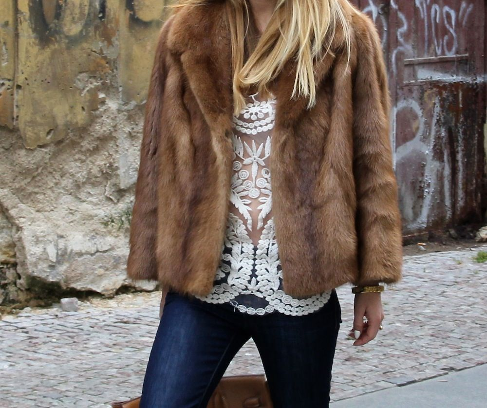 Fashion details. Street style. Lace top and Fur jacket. Blonde hair.