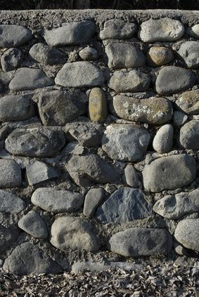 How To Build A Rock Wall With Cement Hunker Stone Walls Garden Rock Retaining Wall Diy Stone Wall