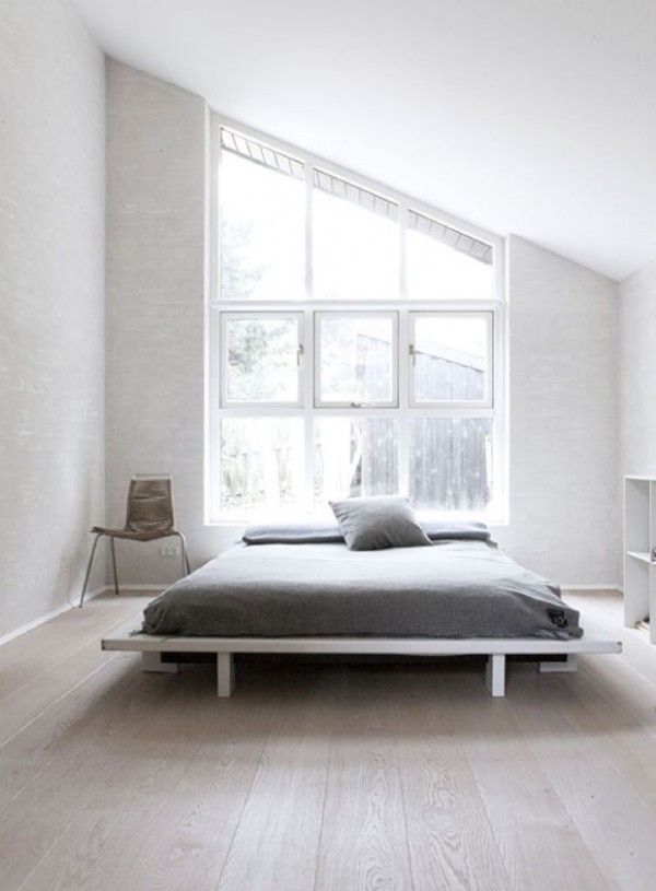 minimal master bedroom with a peaked ceiling