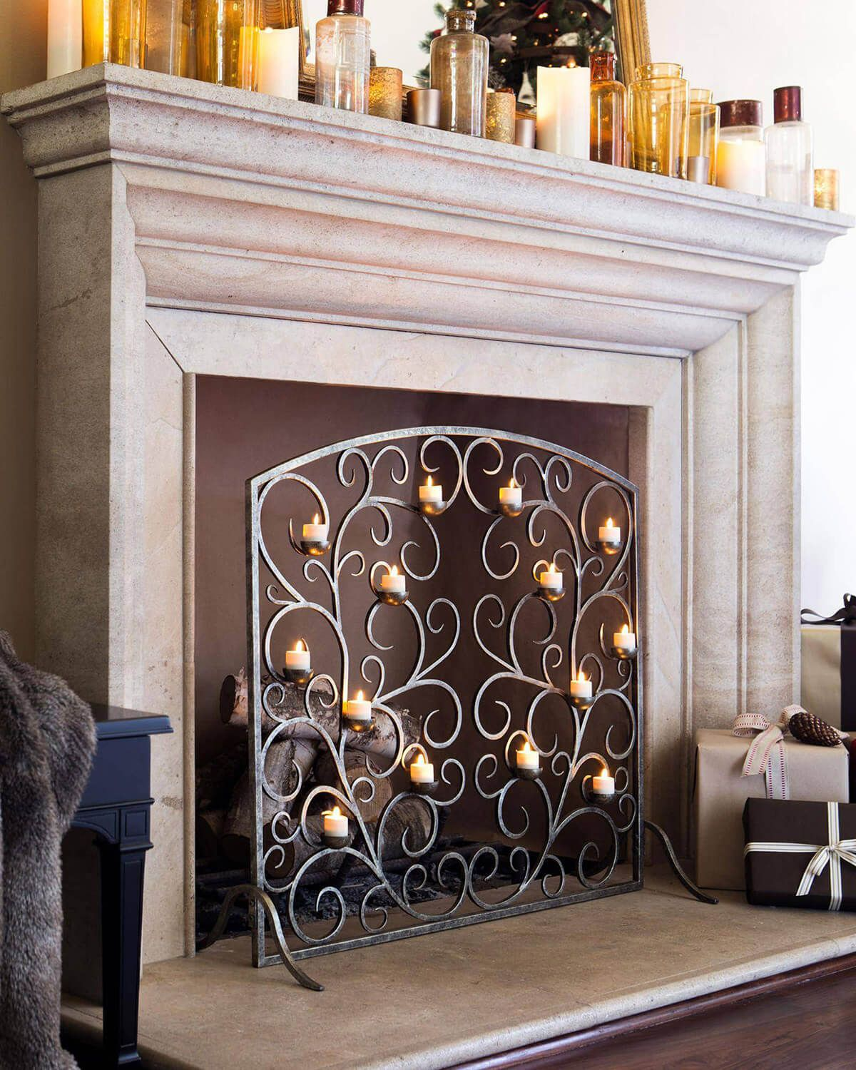14 Ideas To Decorate Your Rooms With Lights And Brighten Up Your Space Candles In Fireplace Decorative Fireplace Screens Faux Fireplace
