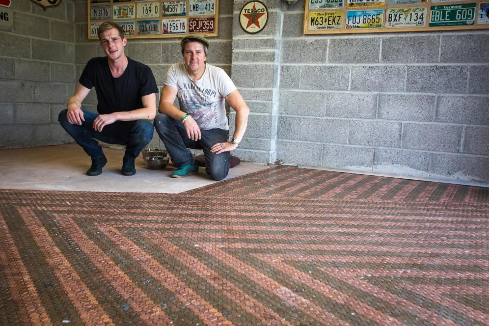 Dad and son lay new garage floor made out of 33,000 2p