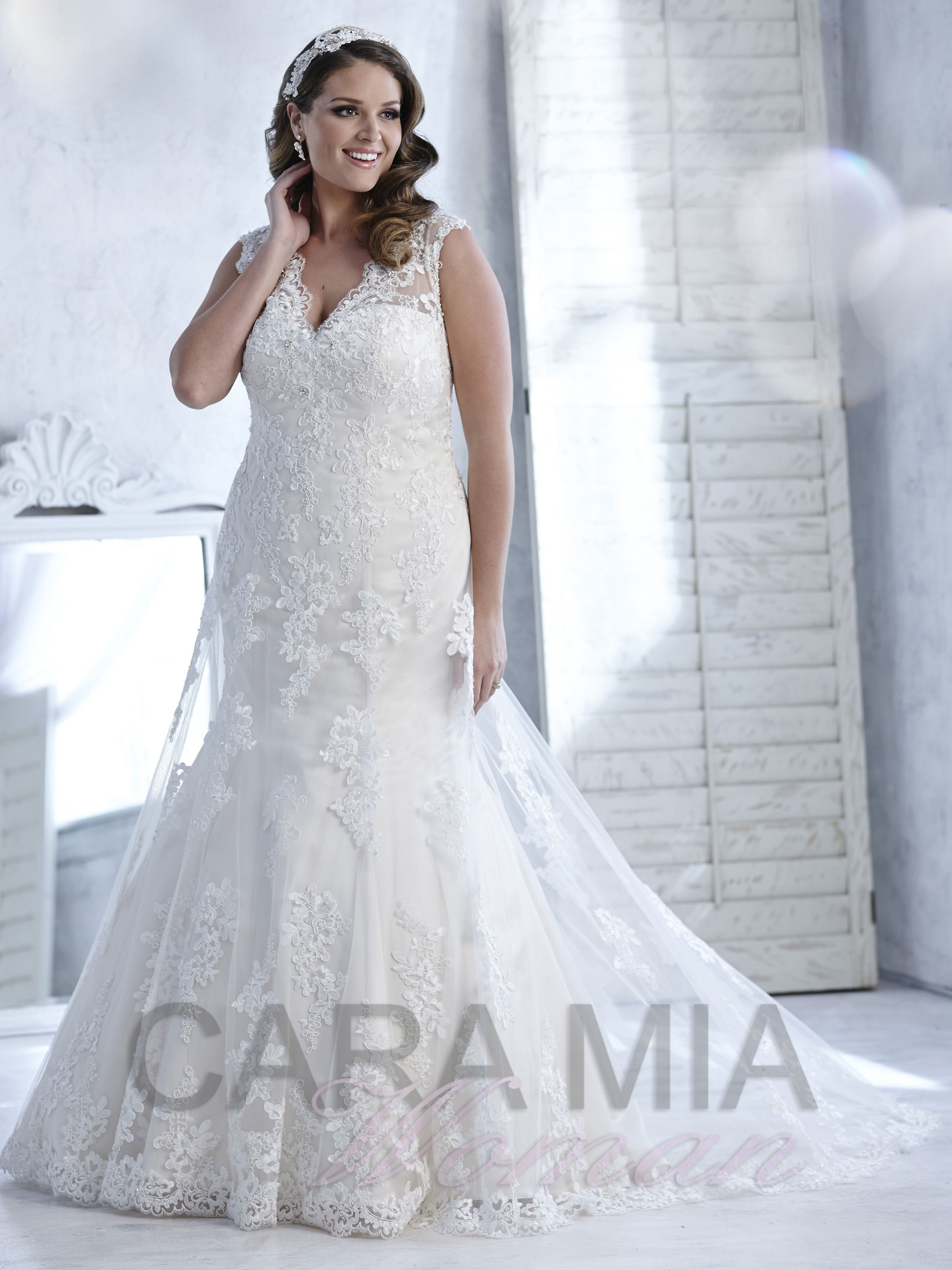 This lace mermaid Cara Mia bridal gown is a SIZE  in Ivory  OUR