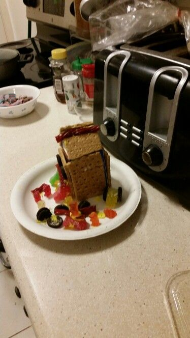 Jer's Gingerbread House 2014. Jer says it's a military base I say it's a teddy bear daycare. #Perception