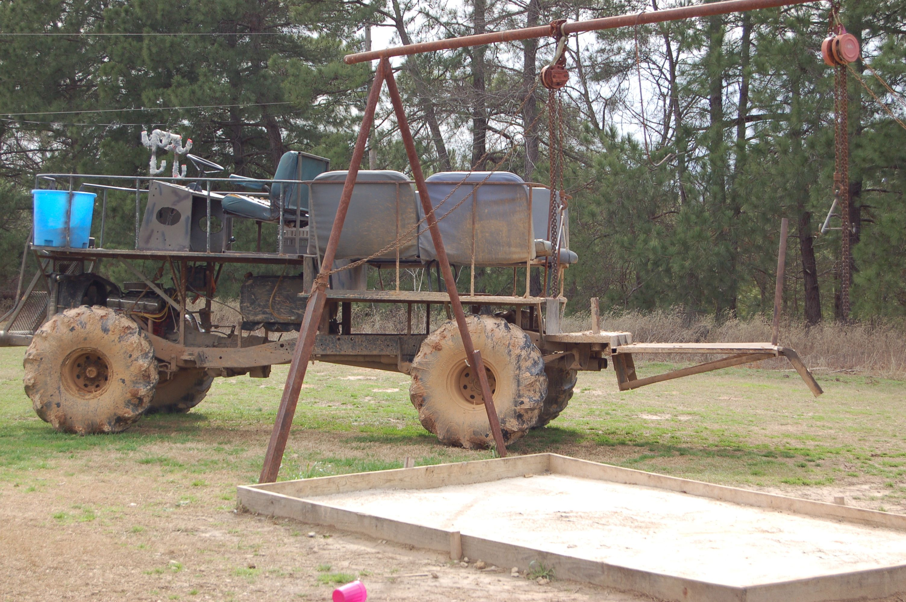 Swamp Buggy next to Skinning area so y'all get an idea of how tall the buggy is