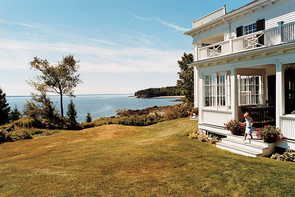 The Maine home of Vogue's Marina Rust. A beautiful front porch and seaside view. Photographed by François Halard, Vogue, 2006