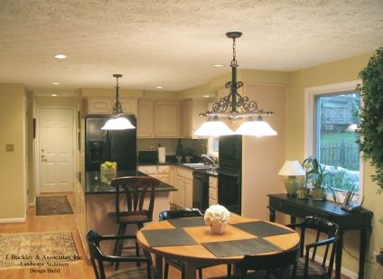 Kitchen renovation with granite countertops and dining window view. http://www.jbuckleyinc.com/Homeimprovement.html