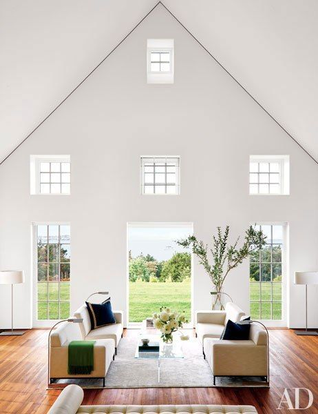 In the living room, square windows frame the Nantucket home's coveted harbor view.