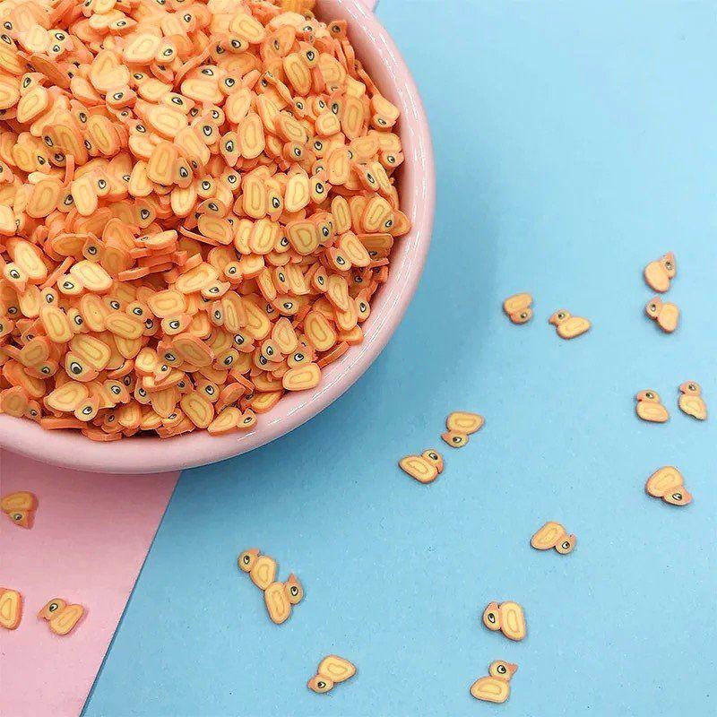 Mini Confettis Canards jaune.Pour une décoration de table originale, ces confettis canard sont parfaites pour une déco canard jaune.Sachets de 10gr et 100gr