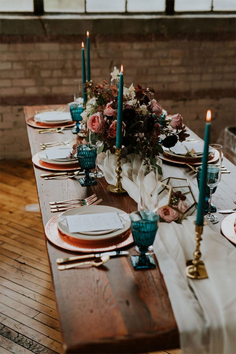Jewel toned wedding table decoration - teal candles , teal glasses and copper plates #weddingtable #weddingdecor