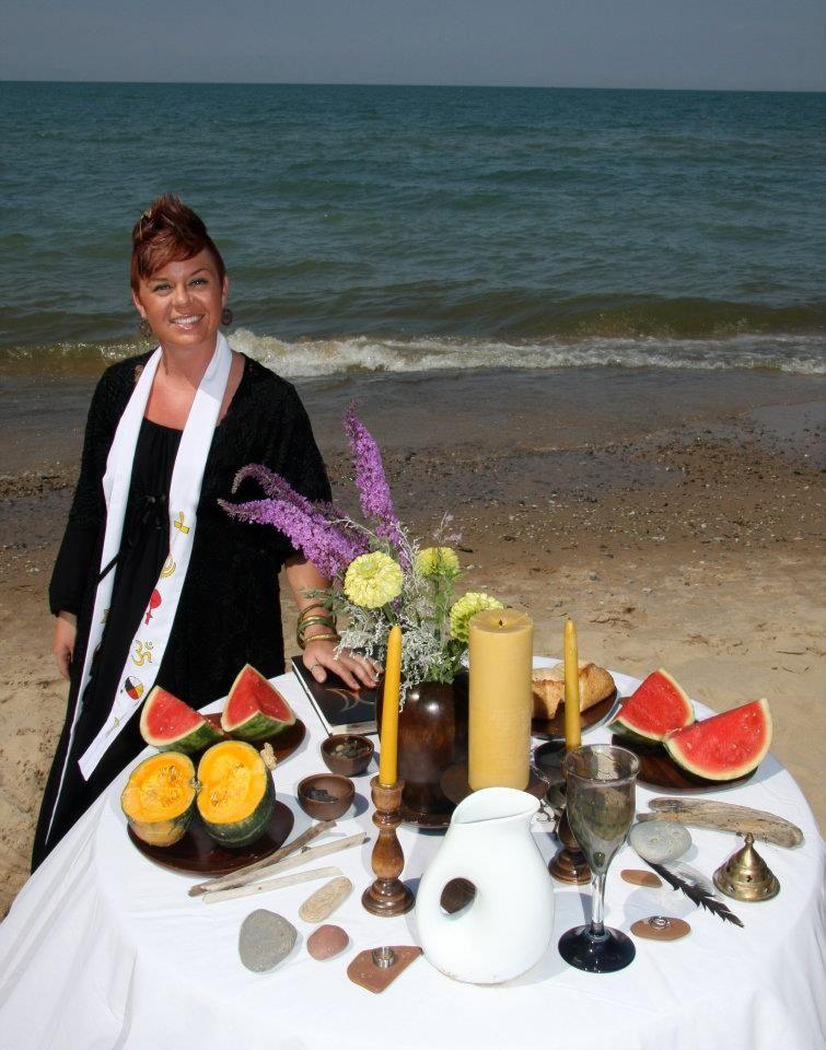 Pagan beach wedding altar by a priestess with a mohawk