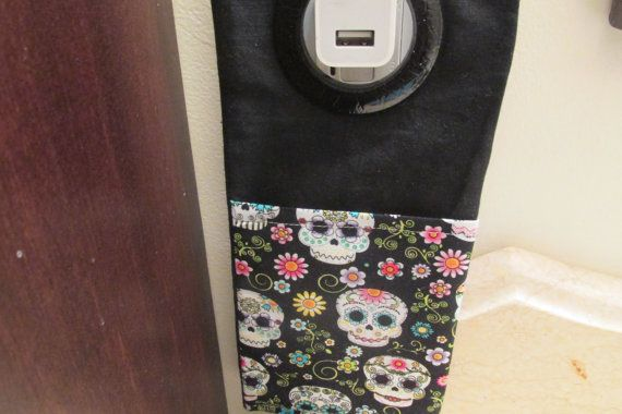 This is a I Phone or small gadget docking station.  The back is black and the pocket is sugar skulls print.  The pocket measures 4 1/2 by 5.  Works