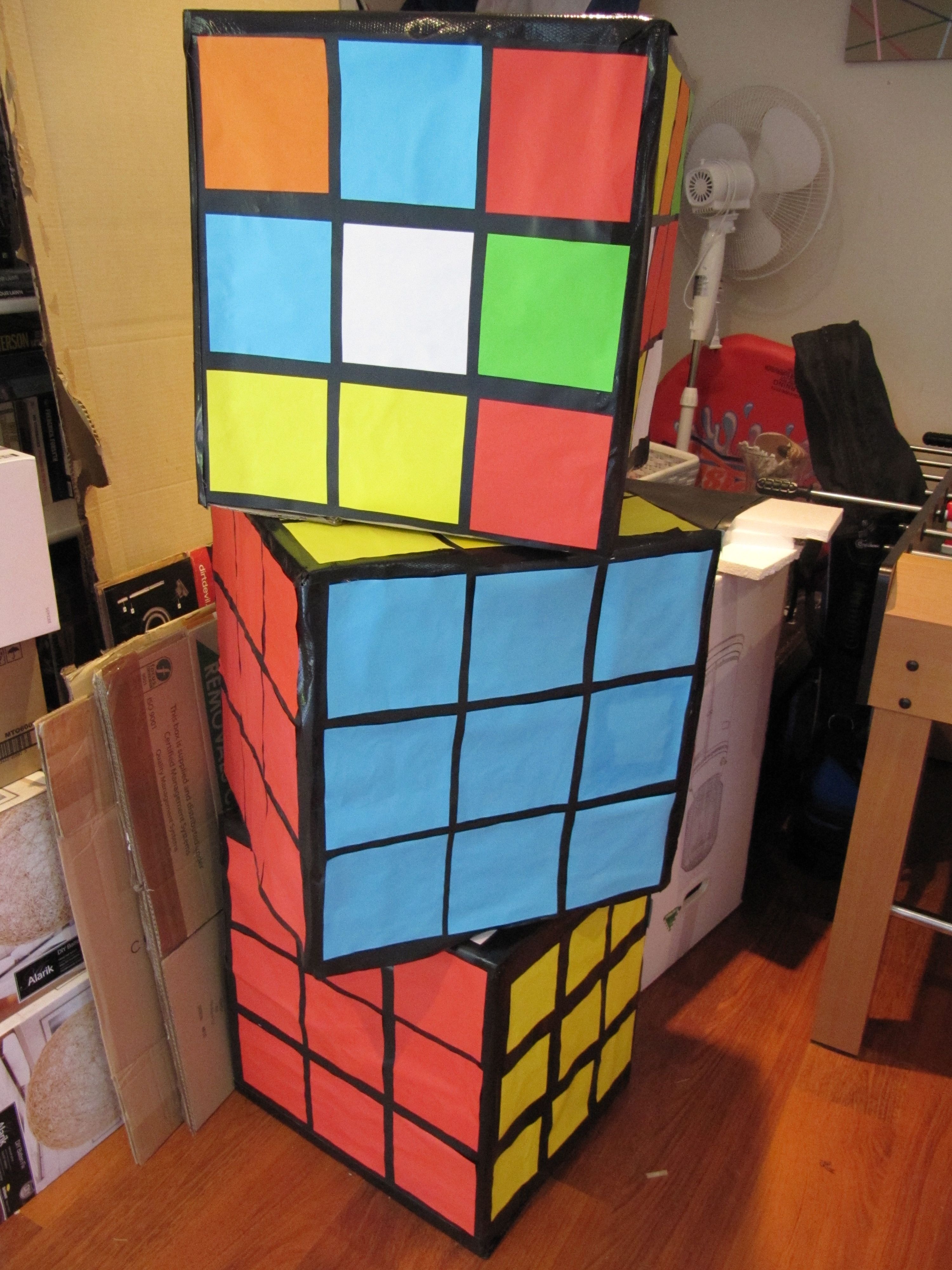 Giant rubik cube made out of card board box 80s theme