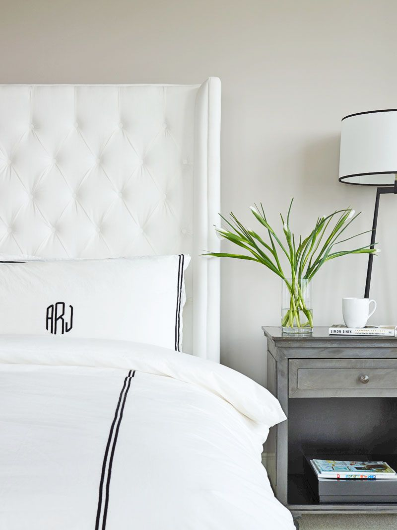 tall white tufted bed white velvet bed zinc bedside table hotel monogrammed bedding
