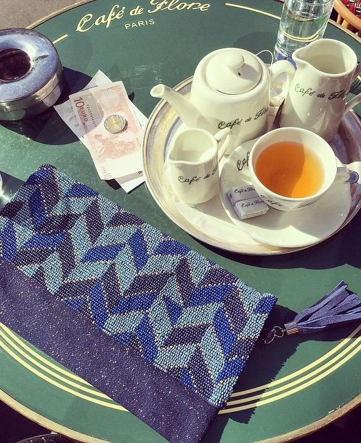 """""""Café de Flore is the best place for people watching on Boulevard Saint Germain and we took full advantage of it on a bright sunny day. My Chico's Tones of Blue Clutch looked right at home at the cafe too."""" - @HabituallyChic"""