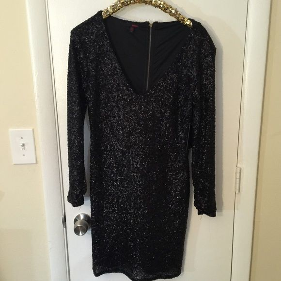 Black sequin dress Gorgeous dress but ordered in the wrong size :( size is juniors 11. Long sleeve with full sequins and lined inside. New with tags BONGO Dresses