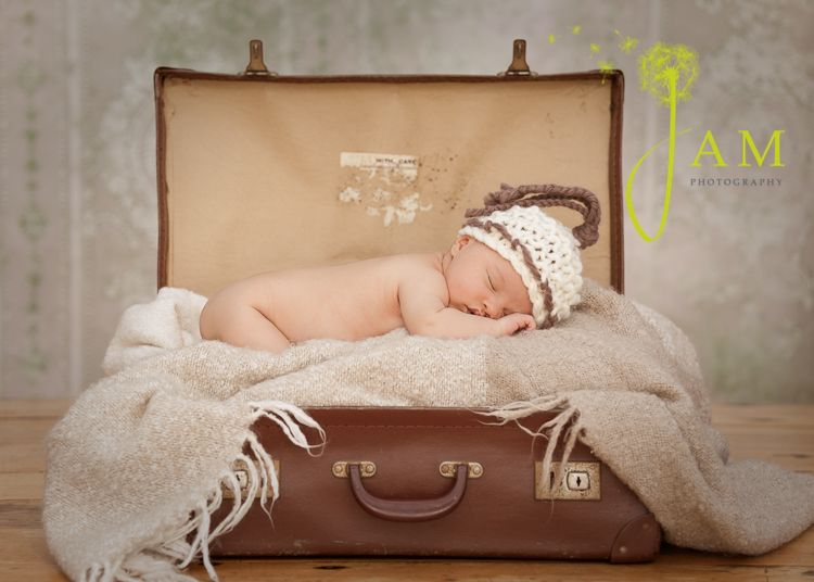 Newborn photo in a vintage suitcase