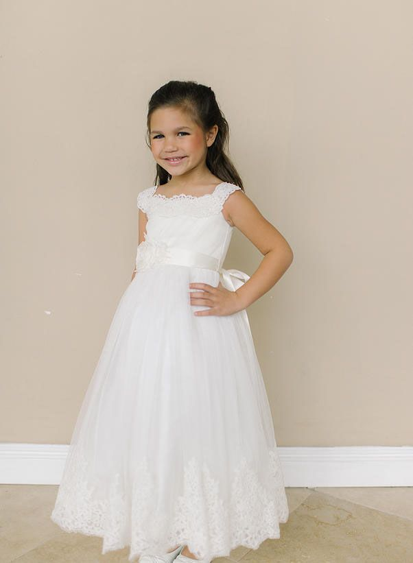 a81db144adaa Precious ivory flower girl dress is the perfect pick for your special day.  Delicate scalloped lace adorns the neckline for an adorable accent.