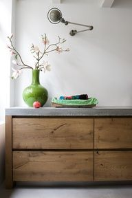 Kitchen: Jielde lamp on wall, concrete counter top and floor, old wood, white painted walls