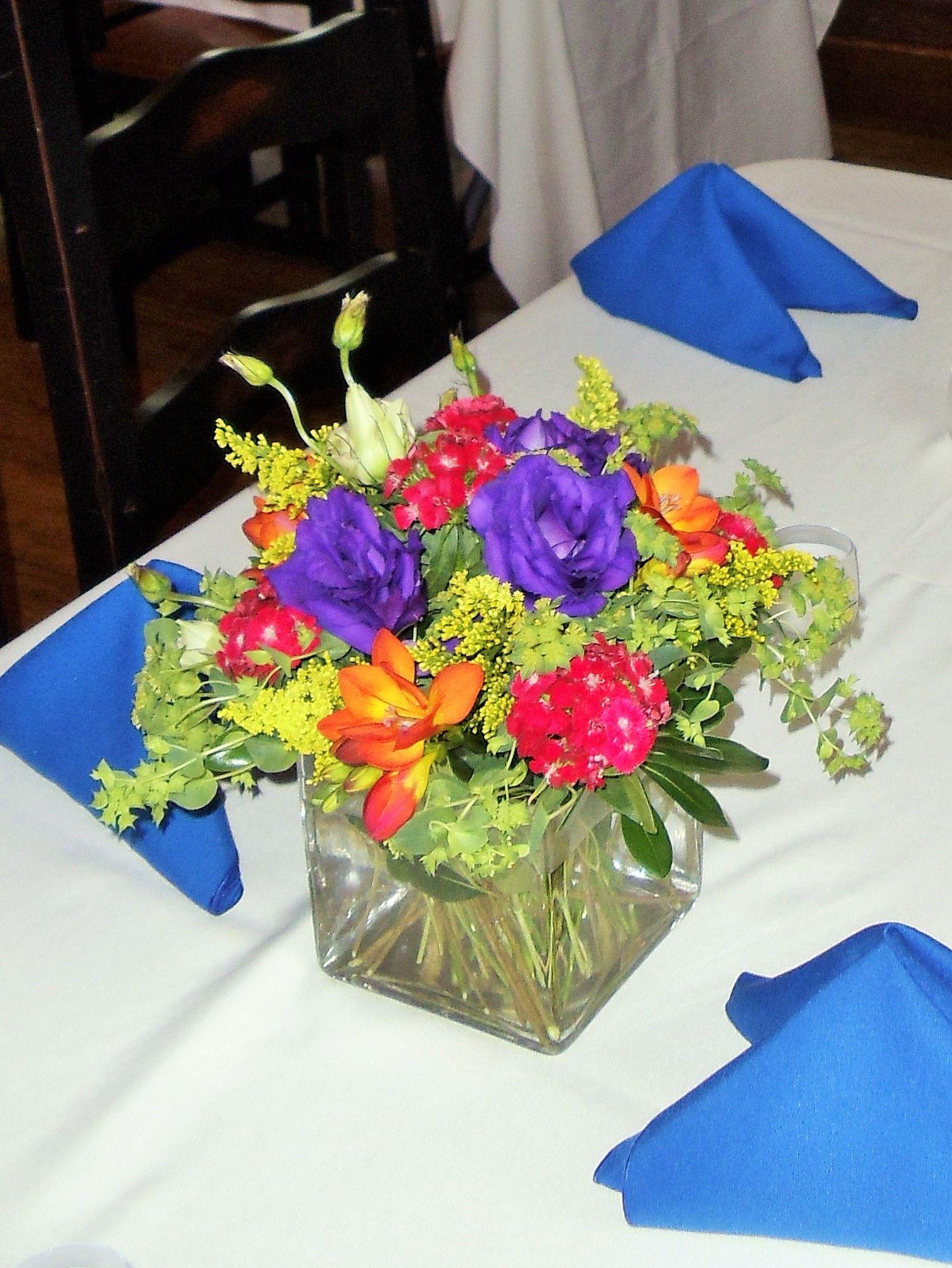 Cube vase filled with lisianthus, dianthus, solidago, bupleurum