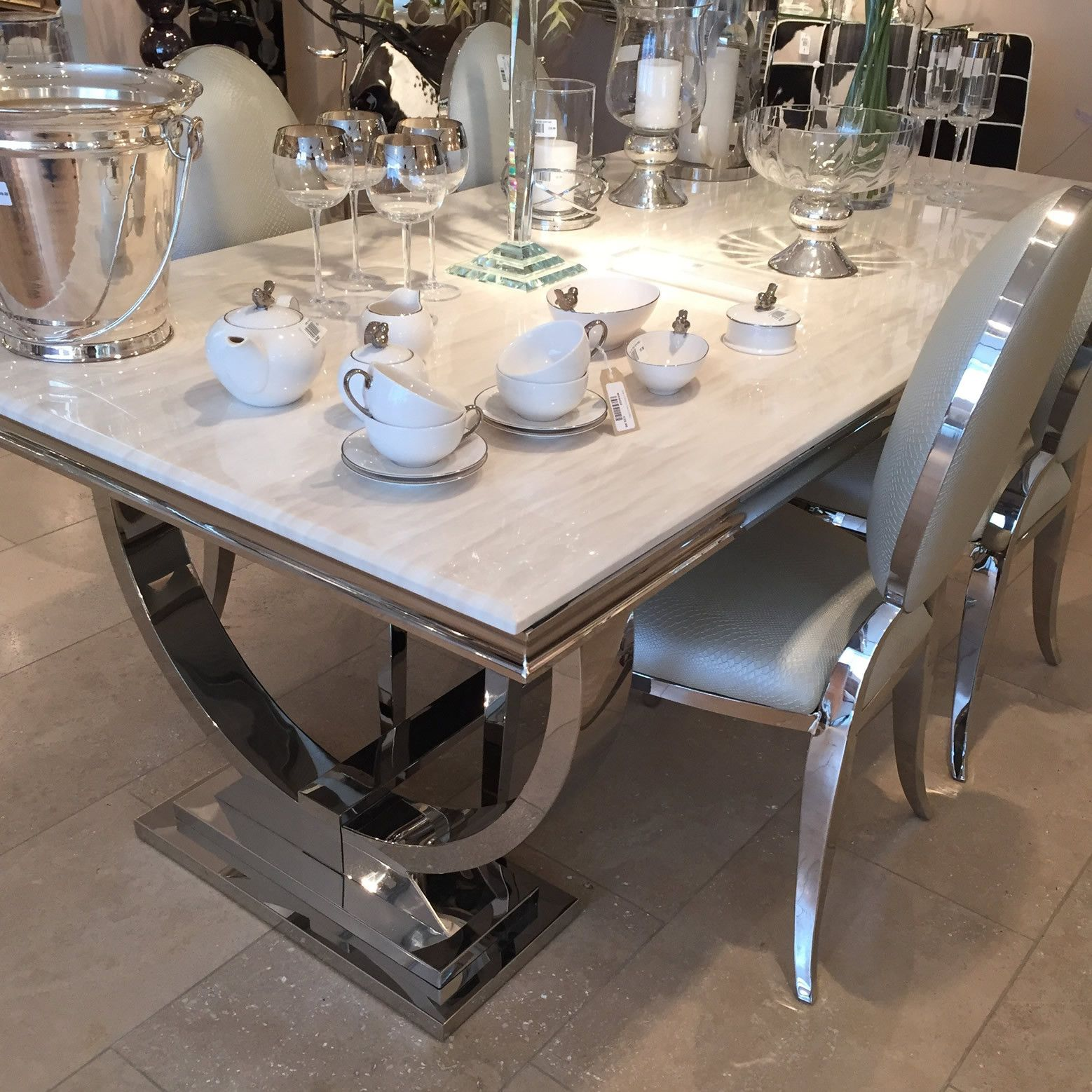 cream marble and chrome dining table with u-shaped legs | marbles