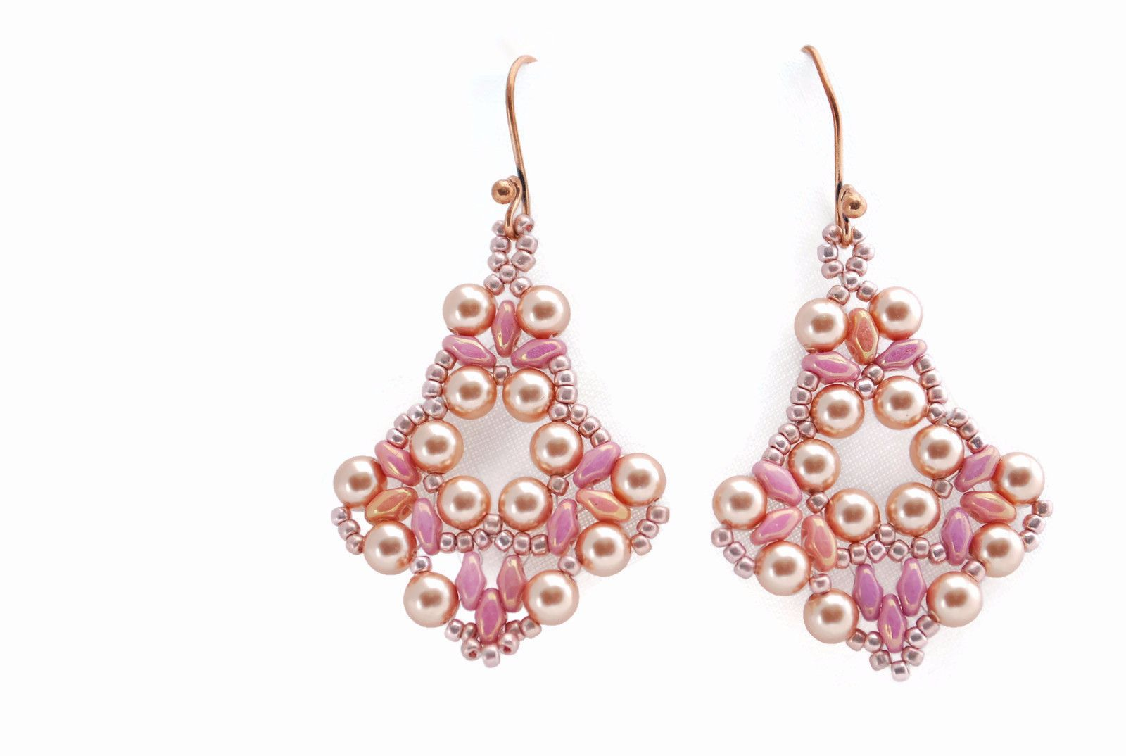 Bold but delicate earrings made with pink superduo beads, pink metallic Toho seed beads and Swarovski pink gold pearls. Hangs 1 1/2 inch from brass ear wire and
