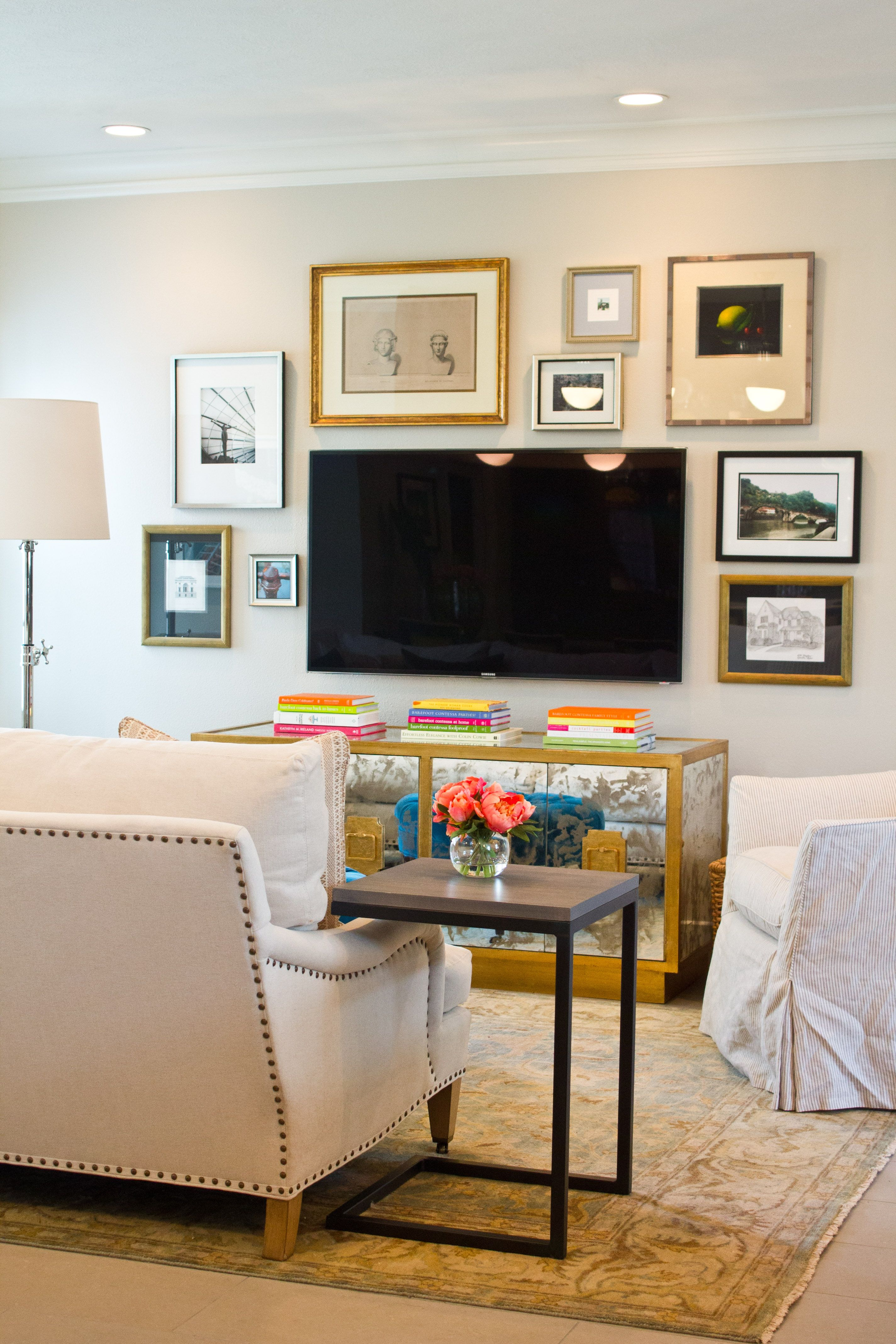 Balanced Gallery Wall With Gold Frames Around Tv Via