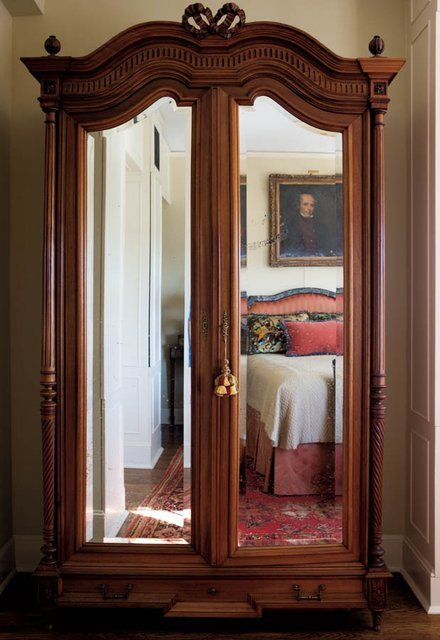 Antique bed, rug, painting in the reflection of a mirrored armoire - Kansas  City - Antique Bed, Rug, Painting In The Reflection Of A Mirrored Armoire