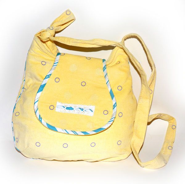 Handmade handbag - Pale Yellow Corduroy Sling AUD59.00 Another gorgeous sling that we have come up with. Made of soft gorgeous pale yellow curduroy sling with white & blue red edging and lace. Inside is fully lined with 3 inside pockets and 1 inner zipper pocket as shown. Magnetic snap closure and adjustable strap length.    Dimensions: 31 wide, X 31cm (tall without strap), 6.5cm depth. http://www.imusthavethat.com.au/pd-handmade-handbag---pale-yellow-corduroy-sling.cfm