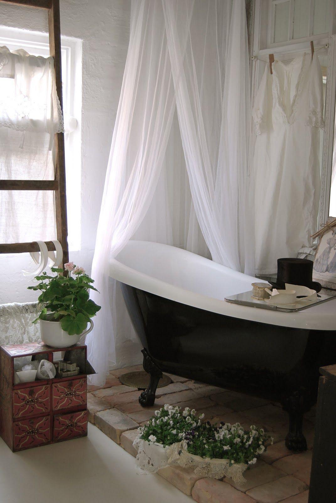 Bath under window ideas  clawfoot tub bricks plants shower curtain love it all  bathtubs