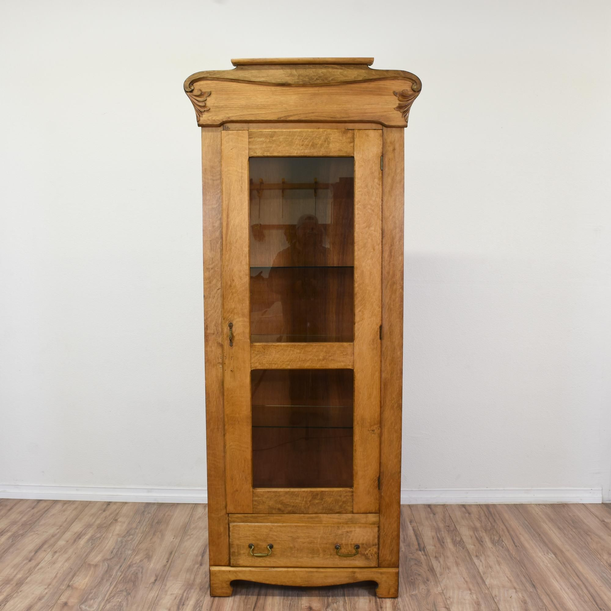 This eastlake inspired display case is featured in a solid wood with
