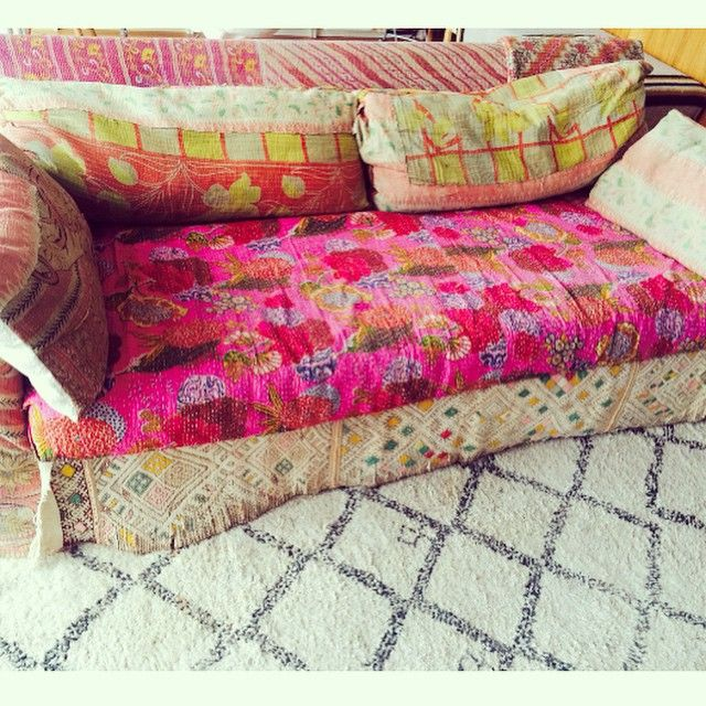 Restoration Hardware couch covered in vintage Kantha quilts and Morrocan rugs .... Also my vintage Beni brown and white rug