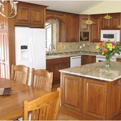 White Kitchen Oak Cabinets dark granite oak cabinets white subway tile white appliances
