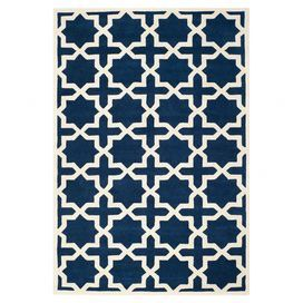 Hand-tufted wool rug with a Moroccan-inspired  motif.  Product: RugConstruction Material: 100% WoolColor: Dark blue and ivoryFeatures:  Made in IndiaHand-tufted Note: Please be aware that actual colors may vary from those shown on your screen. Accent rugs may also not show the entire pattern that the corresponding area rugs have.Cleaning and Care: Professional cleaning recommended