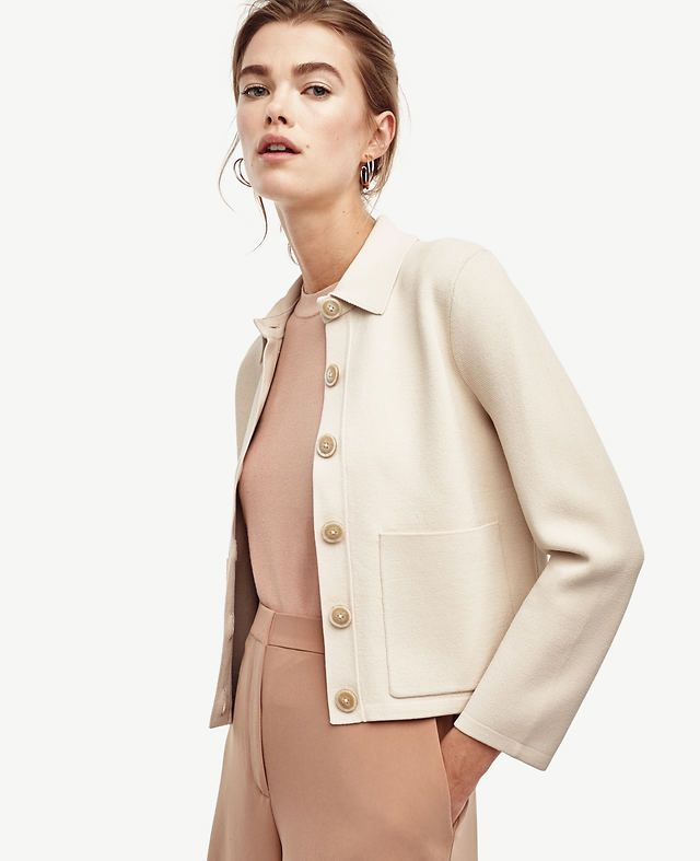 """For an office-ready look that works overtime, this sophisticated knit gets the job done in style. Point collar. Long sleeves. Button front. Patch pockets. 20"""" long."""