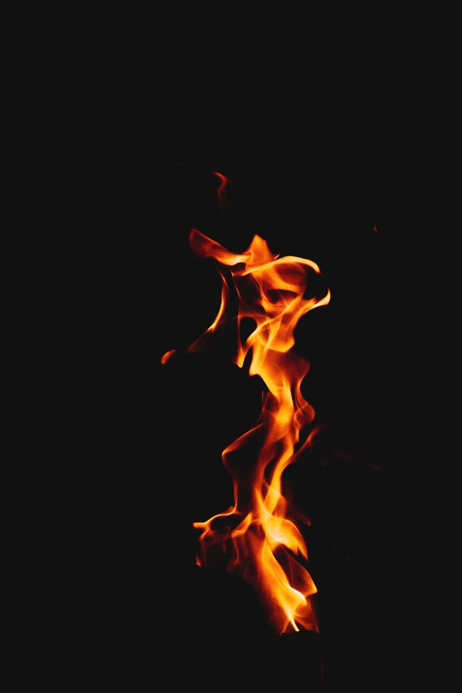 Orange Fire On Black Background Photo Free Fire Image On Unsplash Dark Wallpaper Black Hd Wallpaper Black Wallpaper Iphone Dark